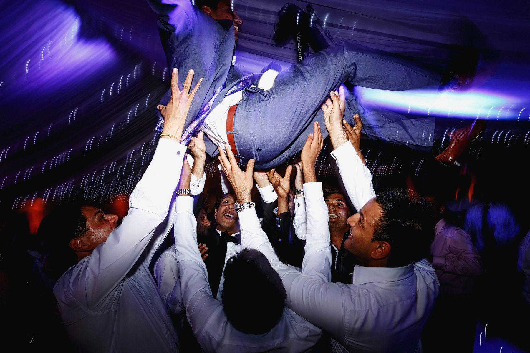 groom-lifted-high-by-guests-by-rahul-khona