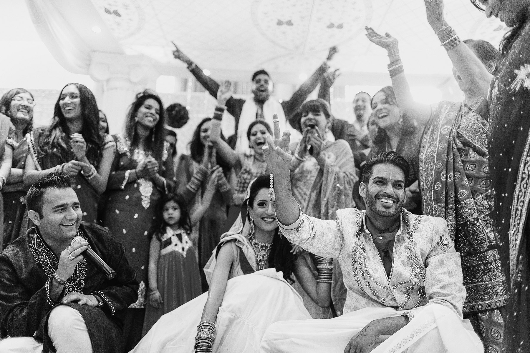 couple-celebrating-with-their-guests-by-rahul-khona